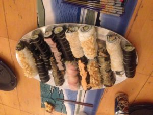 Lots of Sushi! Also ignore the Natty Ice in the background, some of us actually drink good beer.
